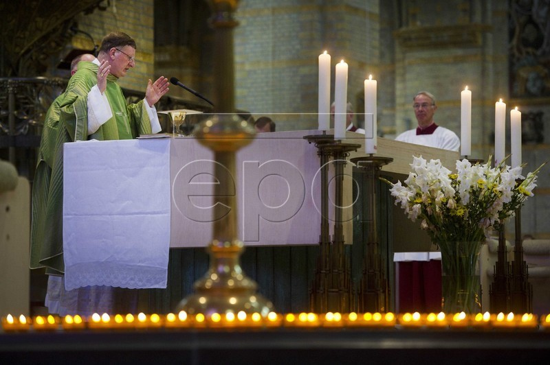 Victims of the MH17 plane crash are commemorated during a memorial service in the Saint Bavo cathedral in Haarlem, The Netherlands (from EPA)